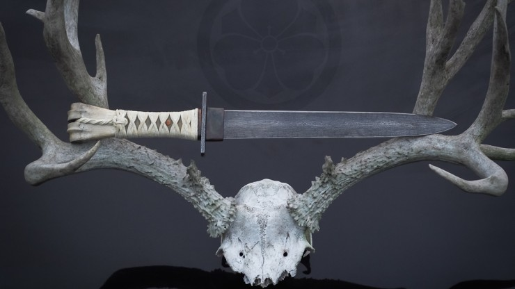A large fusion style dagger, hand forged and hand finished with entirely natural materials in a Japanese inspired mounting.