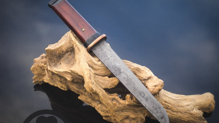 "A 7.5"" hammer-forged tanto blade mounted in rustic satoyama chisagatana style."